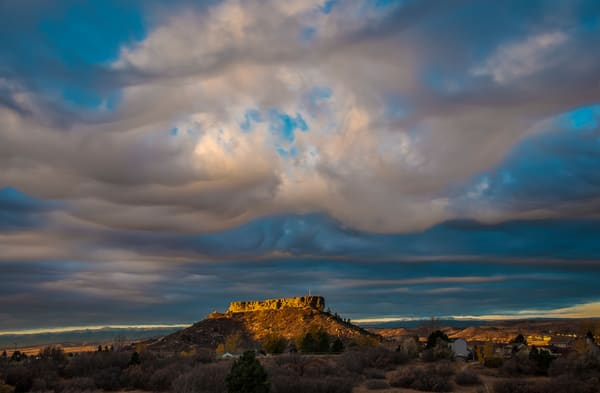 Dramatic Clouds Parting Over Castle Rock as The Rock is Illuminated