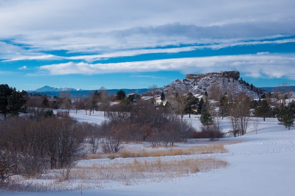 Snow Covered Castle Rock Colorado in Winter with Pikes Peak