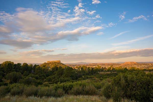 Sunrise Photo of Castle Rock Colorado Warm Gold Toned Clouds