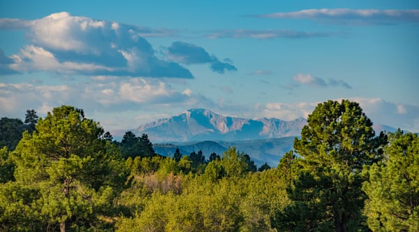 Pikes Peak Blue Skies Dramatic White Clouds View from Castle Rock Colorado