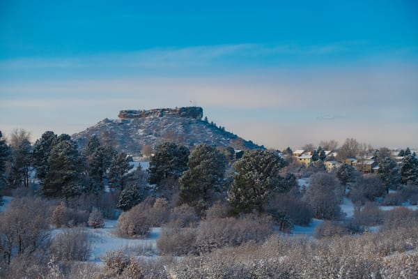 This Sunrise Photo Reveals a Foggy and Snowy Castle Rock Colorado