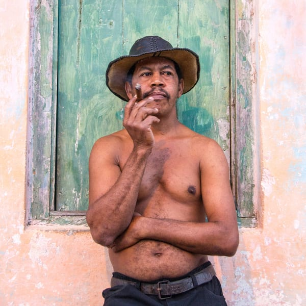 For sale photograph of bare chested Cuban smoking cigar.