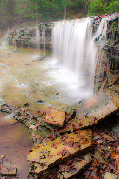Buy this Autumn photograph of Au Train Falls waterfall in Upper Peninsula of Michigan with the Fall color and fallen leaves..