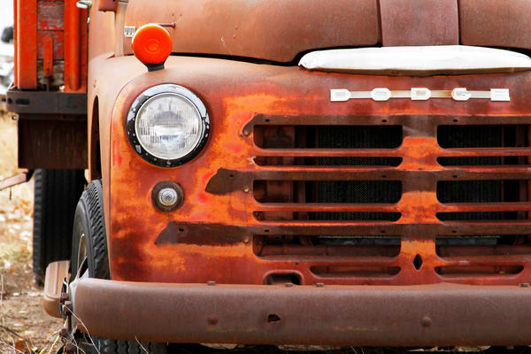 Purchase this photograph of an old Dodge Truck in a junk yard full of old trucks and cars.