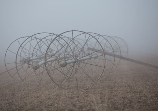 irrigation wheels in frozen fog