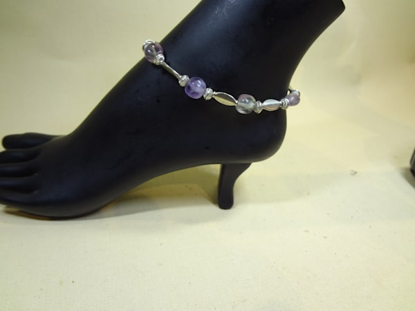 Purchase a stunning Amethyst Anklet hand created by jewelry artisan Peggy Pike.