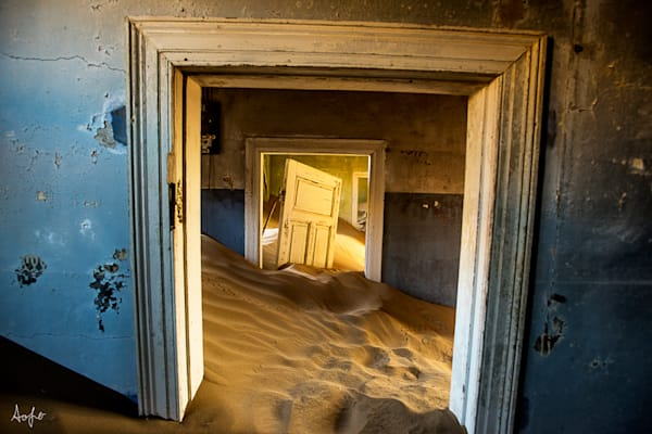 Surreal fine art photograph of desert ghost town house