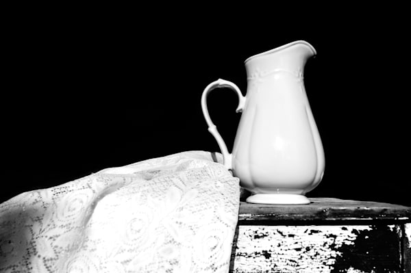 Still life in black & white of a pitcher and lace, for sale as fine art by Sage & Balm