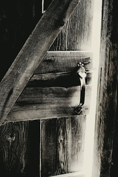 Black & white monochrome photograph of a barn door left slightly ajar, for sale as fine art by Sage & Balm