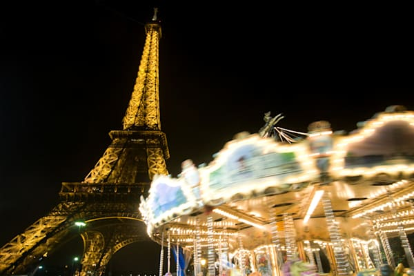 Eiffel tower fine art photograph, at night with spinning carousel in front