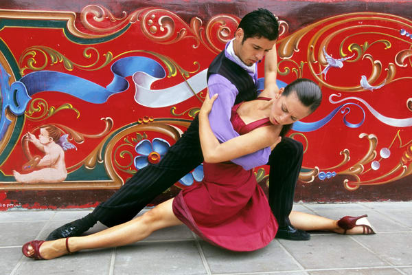 Tango art dancer in extreme pose in front of colorful mural, photograph print.