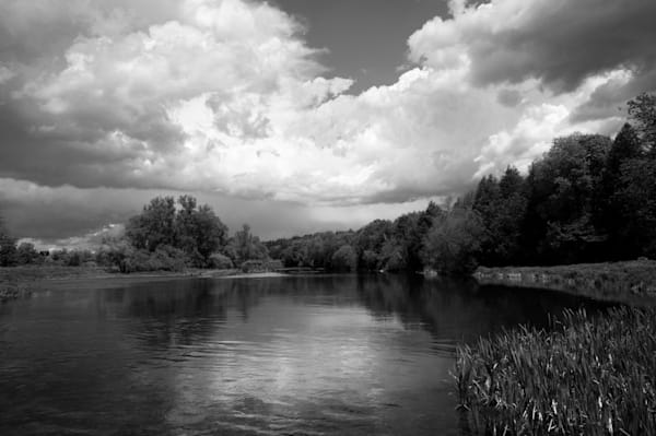 Black & white nature landscape photograph of the Grand River under storm clouds, for sale as fine art by Sage & Balm