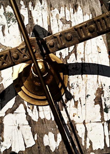 Conceptual & abstract photograph of an antique, golden sundial on a table with chipped paint, for sale as fine art by Sage & Balm