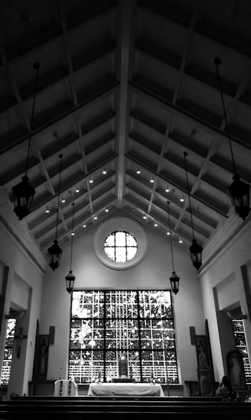 Black & white architectural photograph of the stained-glass windows and vaulted ceiling in the Orlando Basilica chapel, for sale as fine art by Sage & Balm