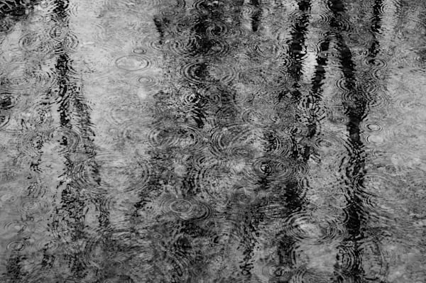 Conceptual and abstract black & white modern/contemporary art photograph of rain drops and reflections on a river, for sale as fine art by Sage & Balm