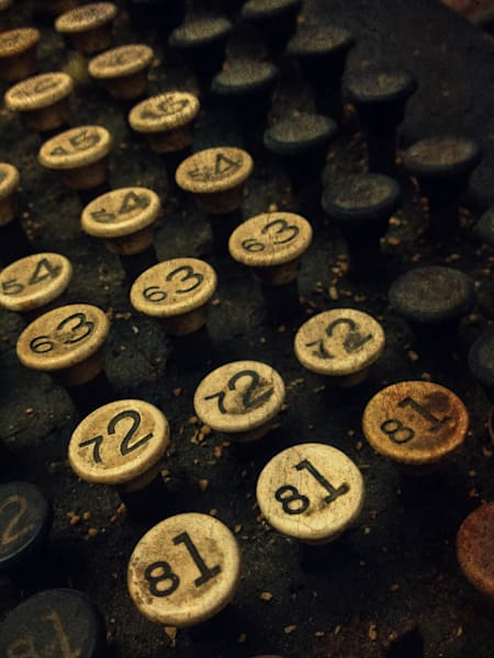 Conceptual & abstract macro photograph of an industrial, antique typewriter in sepia, for sale as fine art by Sage & Balm