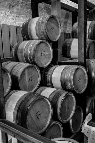 Black & white photograph of antique kegs, stacked at the magazine in historic Fort George, NOTL, for sale as fine art by Sage & Balm