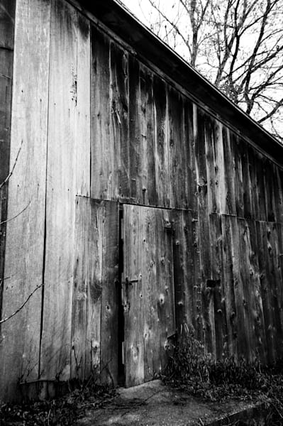 Gritty black & white photograph of an abandoned and decaying shed in rural Ontario, for sale as fine art by Sage & Balm