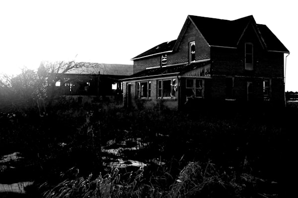 Dark black & white rural decay photograph of a rural Ontario farmhouse, abandoned after a fire, for sale as fine art by Sage & Balm