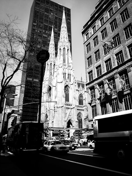 Black & white architectural street photograph of St. Patrick's cathedral in Manhattan, New York, for sale as fine art by Sage & Balm