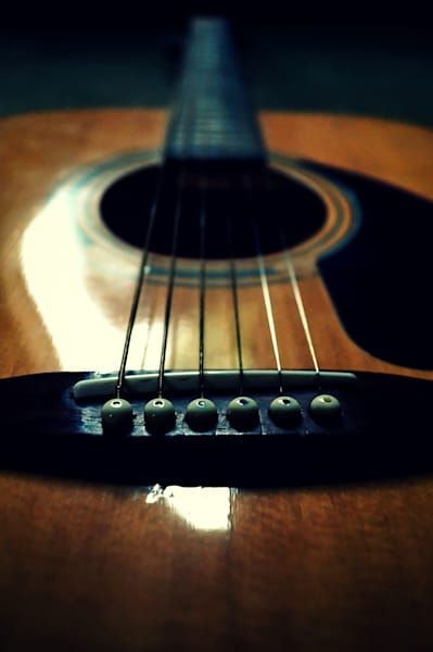 Conceptual & abstract musical instrument photograph of the bridge of an acoustic guitar, for sale as fine art by Sage & Balm