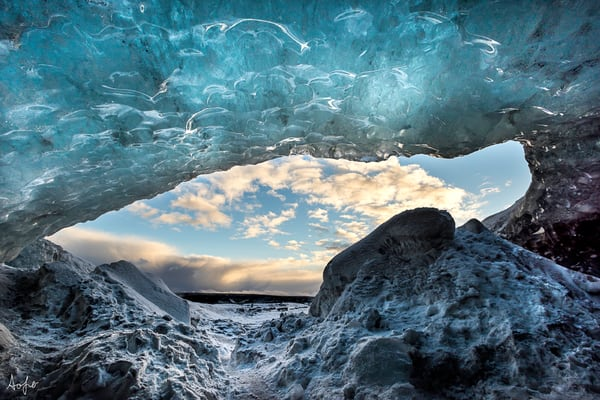 Looking out from an ice cave under a glacier