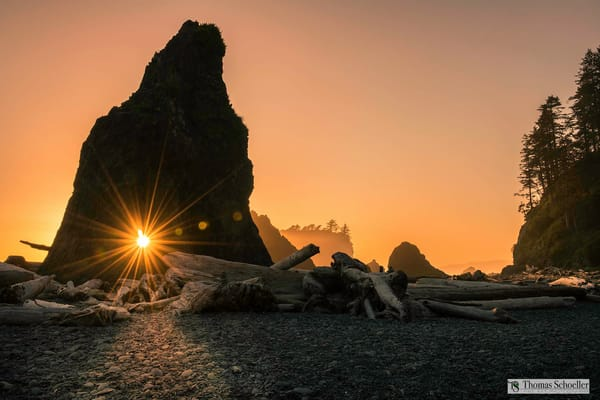 Sunburst peers through a giant sea stack on Ruby Beach/Olympic Peninsula of Washington state creative landscape fine art photography decor prints