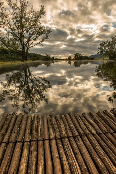 A wood bridge with morning cloudscape, in water reflection, photograph art print