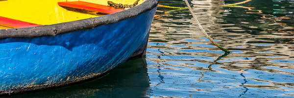 Colorful rowboat in rippled water in panorama fine art photograph