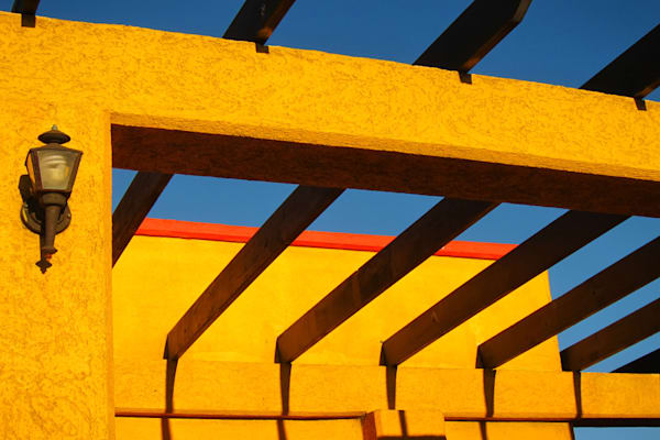Adobe yellow architecture with beams and lantern