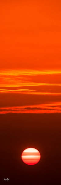 art photograph , vertical panorama of sunset and orange sky