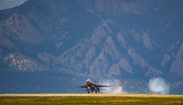 Photo of Air Force F-16 Viper Landing with Swirling Clouds from Wheel Touchdown