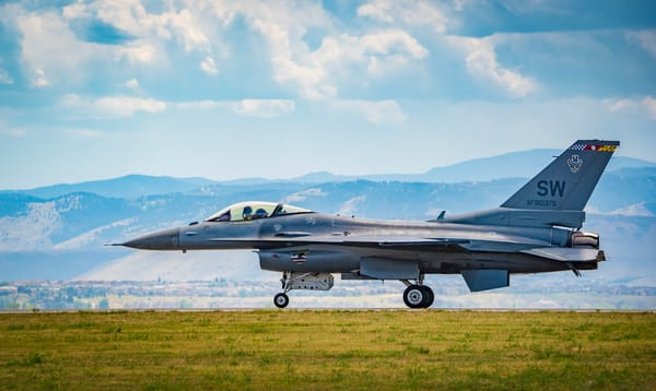 Photo of Air Force F-16 Viper Taxing Runway Colorado Rocky Mountains Backdrop
