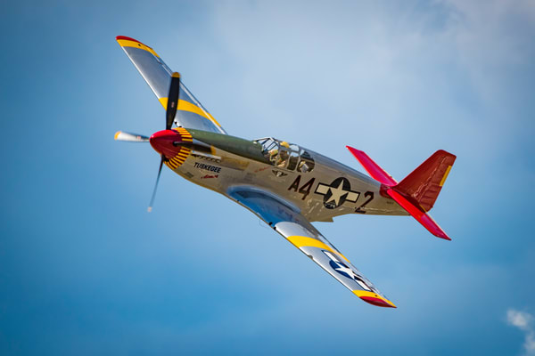 Photograph of Tuskegee Airmen P-51C Mustang Fly By