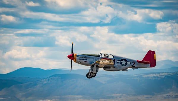Photo of Tuskegee Airmen P-51C Mustang Over Colorado Rocky Mountains