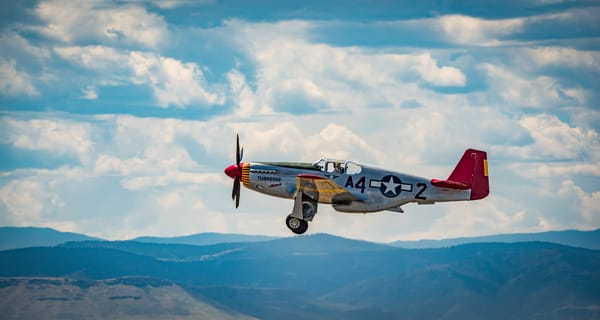 Photo of Tuskegee Airmen P-51C Mustang in Fight Over Colorado Rocky Mountains