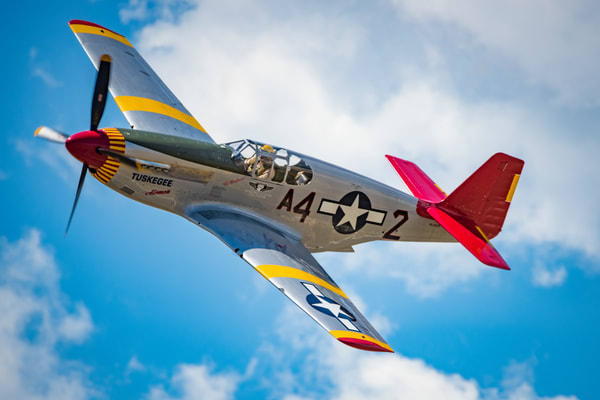 Photo of Tuskegee Airmen P-51C Mustang High Speed Flyby Colorado Airshow