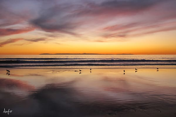 Fine art photograph of Newport beach sunset with mirror reflection on sand