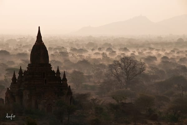 Silhouetted Buddhist ruin, fine art photograph from the air