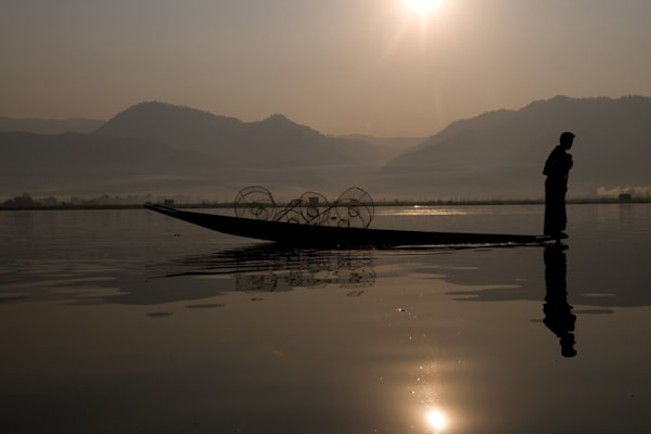 fine art photograph of foot rower in silhouette with perfect reflection