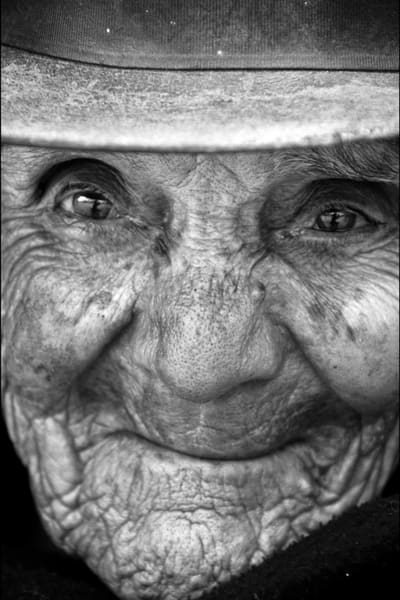 Fine art Black and white photograph of close-up of Colombian elderly woman