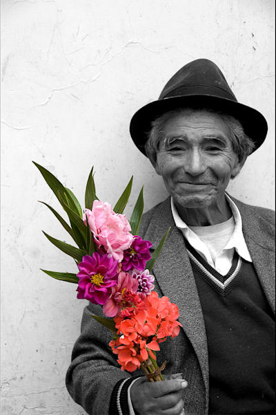 Smiling man in black and white photograph holding colorful flowers, art print