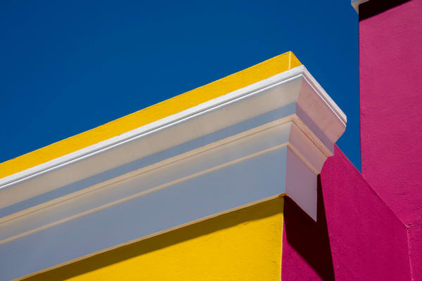 A detailed view of a colorful house roof trim, in art photograph print
