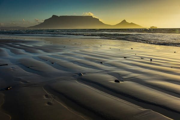 Fine art photograph of Table mountain at sunset from sand beach