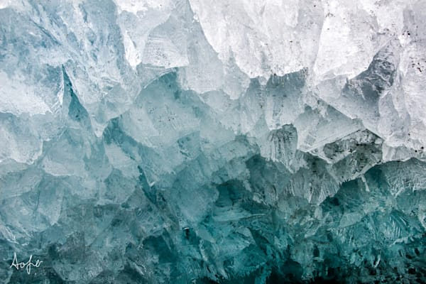 Blue glacier ice cave with natural pattern.
