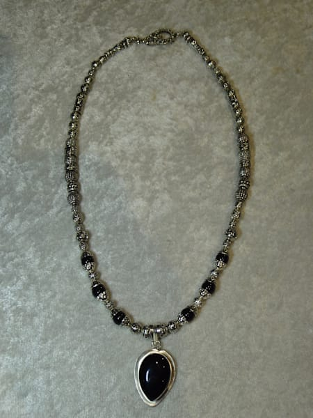 Peggy Pike artisan jewelry, metals and gemstones.