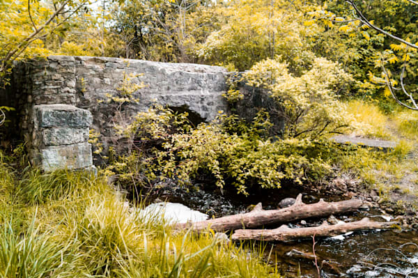 Nature & landscape photograph of a stone bridge over a river in Elora, Ontario in the autumn, for sale as fine art by Sage & Balm