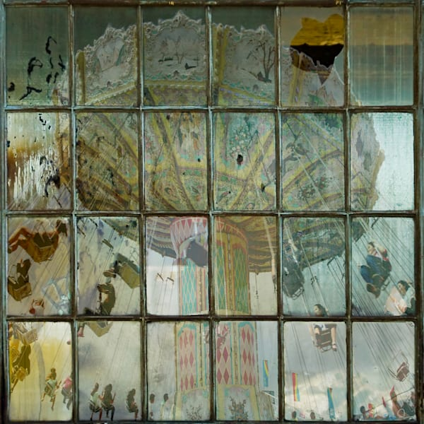 A layered photograph of an Antique Swing Amusement Ride through industrial window panes for sale by Michael Toole.