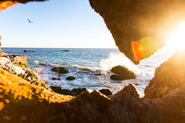 View Through Rocks At Point Dume Photograph For Sale As Fine Art