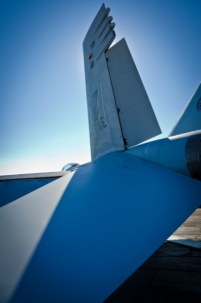 Photo of tail of McDonnell Douglas F-18 Hornet Combat Jet from Back